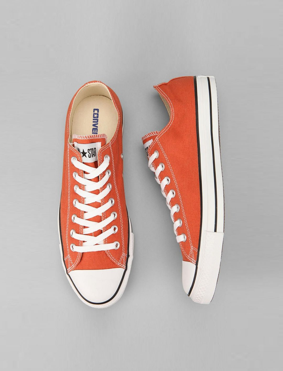 "Orange Sneakers {""id"":12,""product_section_id"":1,""name"":""Shoes"",""order"":12} Converse"