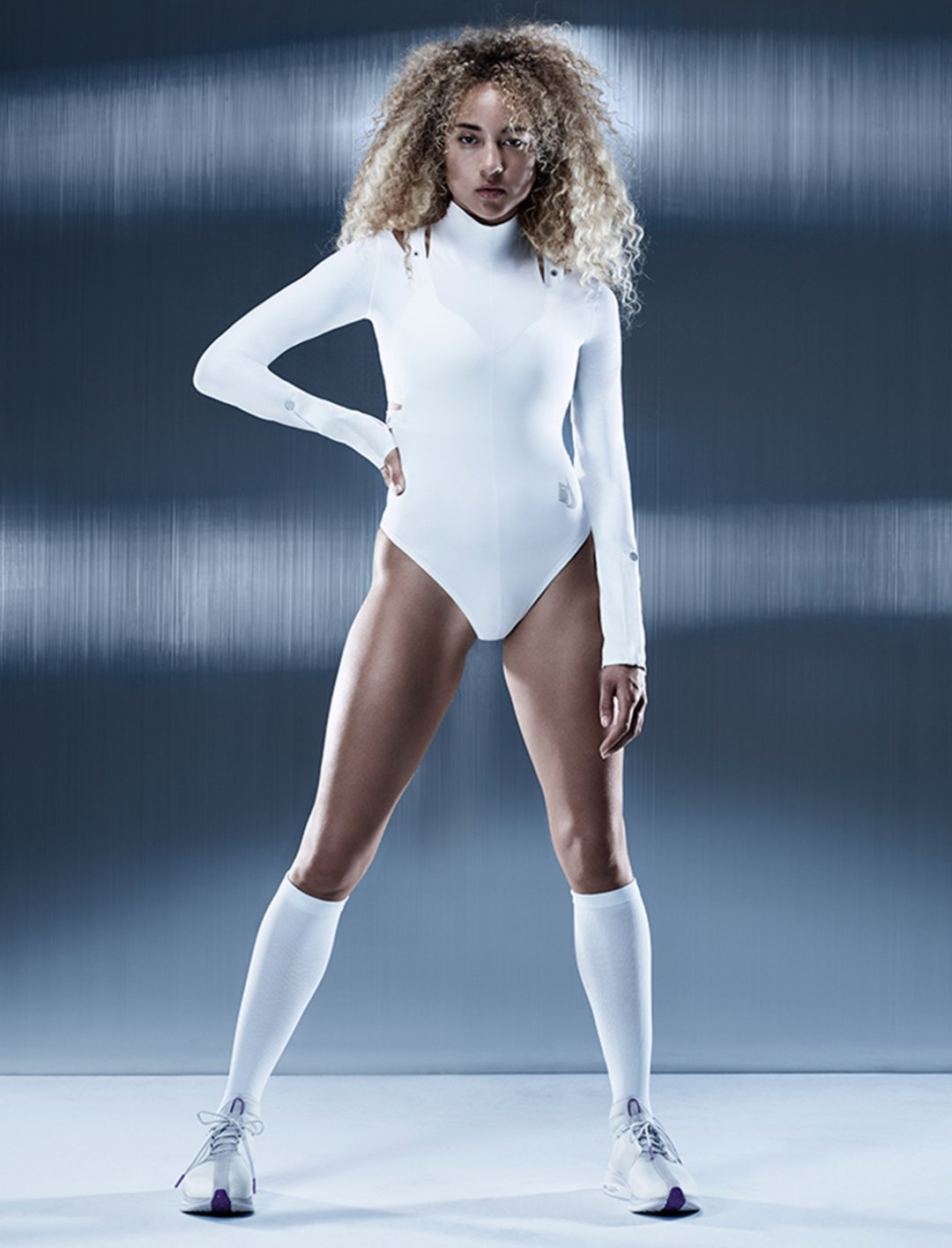 "White Bodysuit {""id"":5,""product_section_id"":1,""name"":""Clothing"",""order"":5} NIKE"