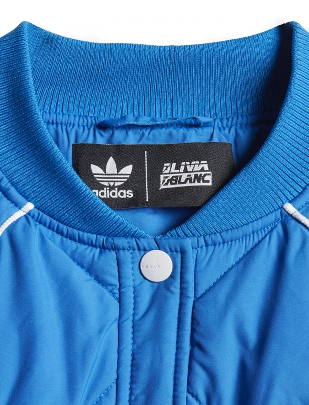 "Quiled Track Jacket {""id"":5,""product_section_id"":1,""name"":""Clothing"",""order"":5} adidas x Olivia Blanc"